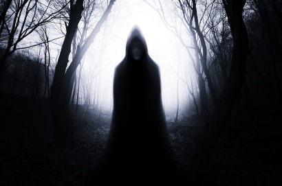 ghostly figure in dark scary forest